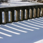 Sunlight and shadow through the railing of bridge 3481, constructed in 1921 by the Minnesota Department of Highways
