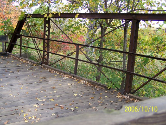 Looking northwest at the bridge's iron structure.