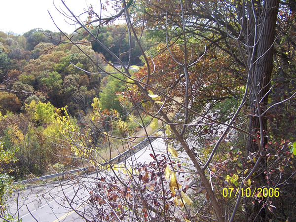 The view of modern U.S. 14 from the end of the old road, now a sheer cliff. The entrance to the scenic overlook is just visible in the lower left corner of the shot.