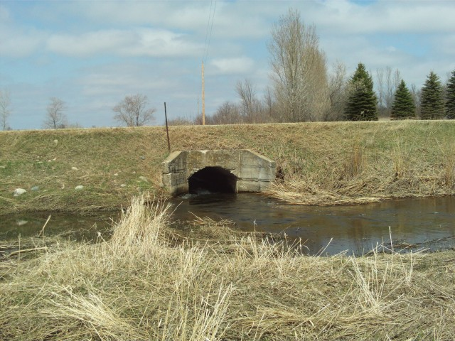 An old concrete culvert under the old road, a little further east.