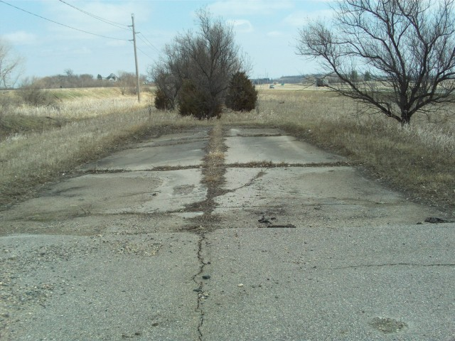 "Another surviving piece of old concrete, on the east end of what is now shown as ""Main Street"" on the south side of Audubon along the north side of modern U.S. 10."