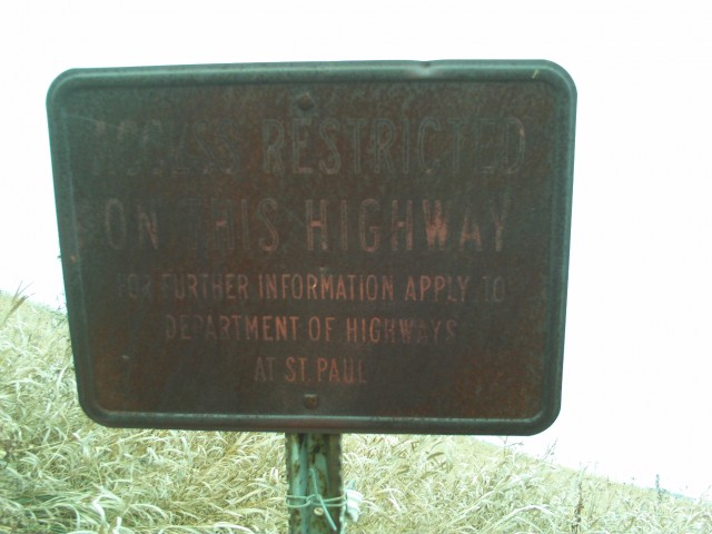 A rusting highway sign along old U.S. 10.