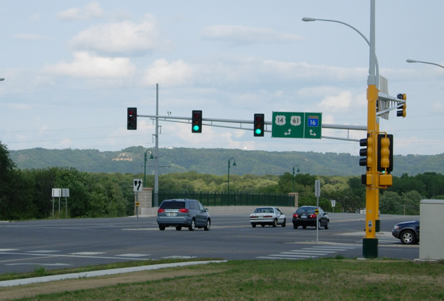 Route signage in La Crescent, showing Highway 16 continuing east towards the Wisconsin State Line